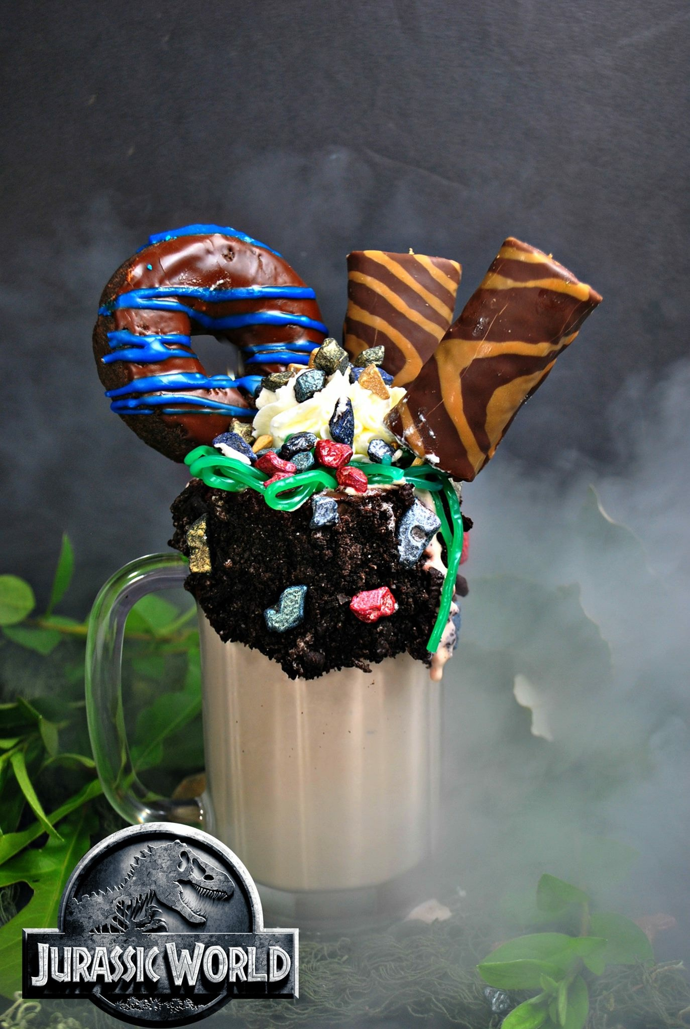 "Inspired by the Jurassic World films, this dinosaur milkshake recipe is over-the-top ""freakshake"" style. Make it with the kid and enjoy together. #JurassicWorld #FallenKingdom #Dinosaur #Freakshake #Milkshake #Dessert"