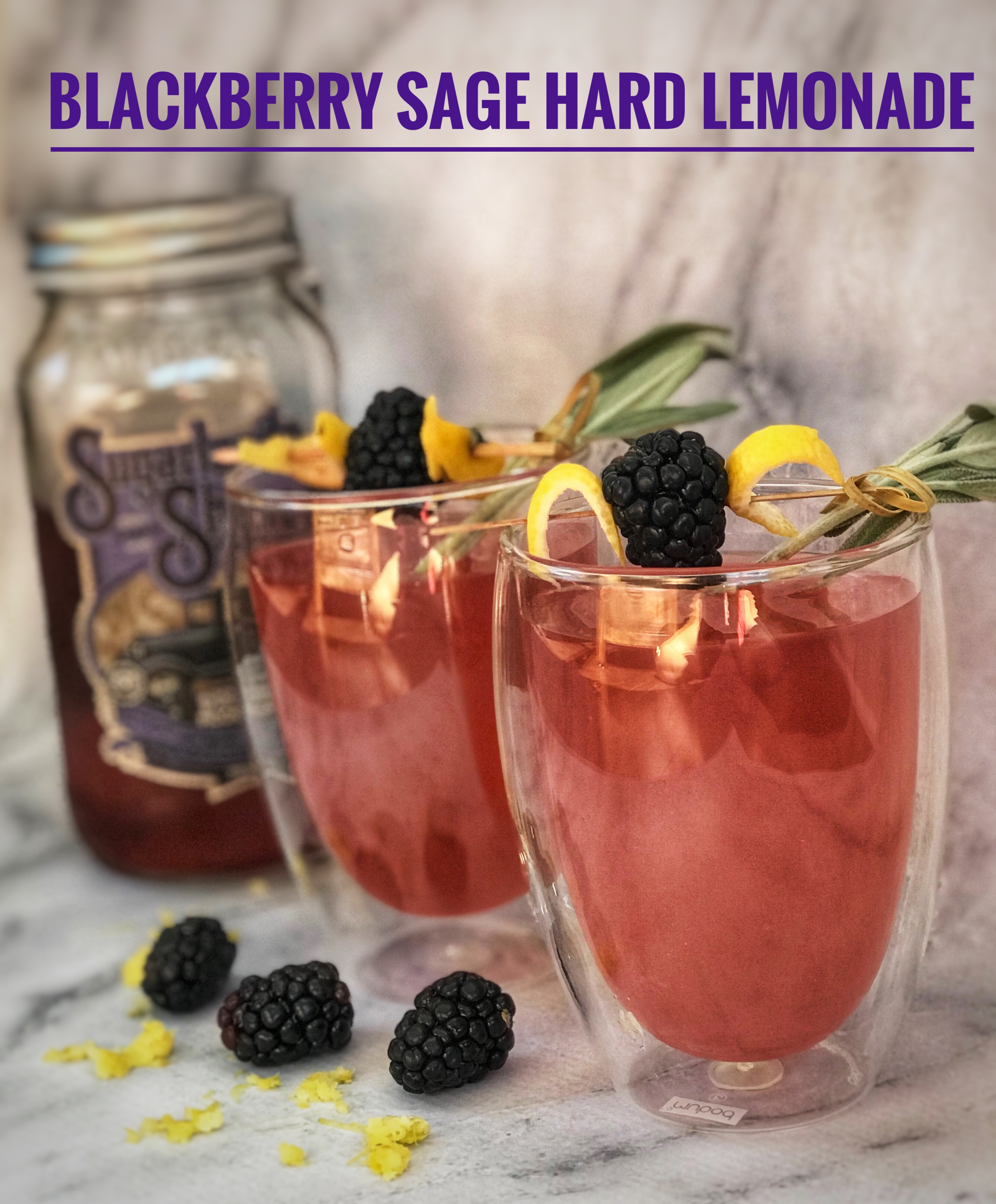 Sip on this perfect drink for summer! Featuring savory and sweet, this Blackberry Sage Cocktail is made with Sugarlands Blockader's Blackberry Moonshine and fresh lemonade. It's delicious! #AD