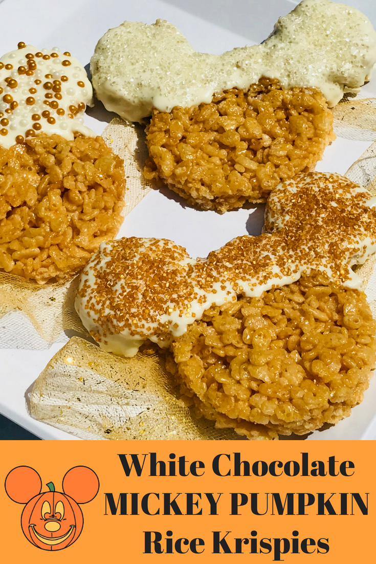 These White Chocolate dipped Mickey Pumpkin Rice Krispies Treats are perfect for Fall. They taste like pumpkin and you can let the kids help you decorate. Fun for a Halloween party too. #Halloween #HalloweenRecipe #DisneyRecipe #Mickey #RiceKrispies #FallBaking #FallRecipe
