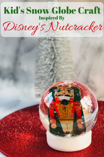 Make this easy Christmas Snow Globe craft, with the kids. It's inspired by Disney's Nutcracker movie. Costs less than $12 to make and 25 minutes time. #DisneysNutcracker #NutcrackerCraft #KidsCrafts #ChristmasCrafts #HolidayCrafts #Crafts #SnowGlobe #DIY