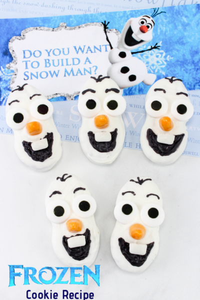 Make these cute Olaf Cookies that are inspired by Disney's Frozen movies. They're made of Nutter Butter cookies and perfect as Christmas cookies or a Frozen them birthday party. #Frozen2 #FrozenRecipe #Olaf #DisneysFrozen #Disneyrecipe