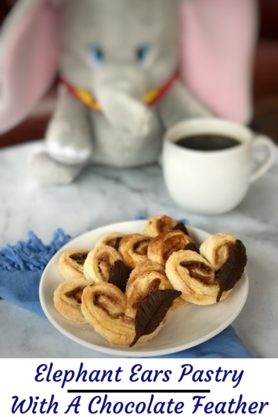 Inspired by Disney's live action Dumbo movie, these elephant ears pastry are flakey, buttery and topped with a milk chocolate feather! A perfect pairing for your coffee. #DisneysDumbo #ElephantEarsPastry #BreakfastPastry #PuffPastry #Dumbo #DisneyMovies
