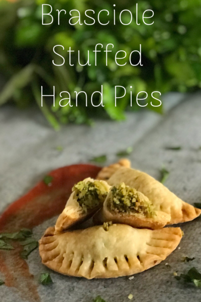 These brasciole stuffed hand pies are an easy Italian appetizer recipe. The stuffing is both sweet and savory then wrapped in a flakey pie crust. Serve with marinara for dipping! #Appetizer #Italian #Pie #HandPies #MiniPie