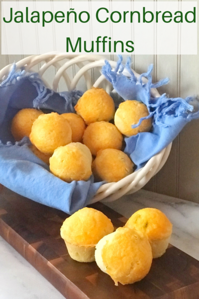 These moist cornbread muffins are the perfect accompaniment to chili! They're baked with jalapeño and cheddar cheese. Serve warm with butter and enjoy! #Cornbread #CornbreadRecipe #Muffins #chili #quickbread #quickbreadrecipe