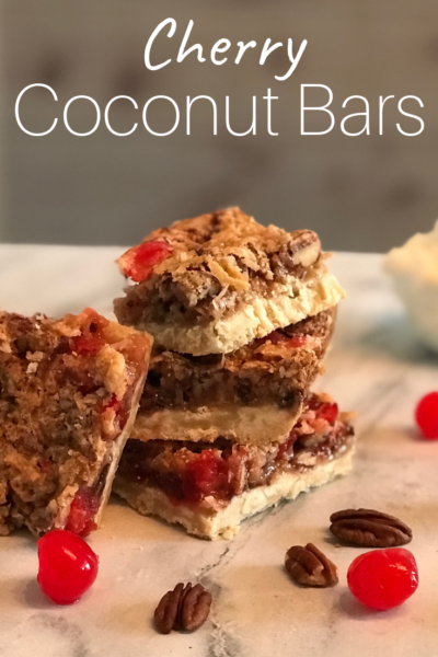 Cherry Coconut Bars: A chewy, nutty and sweet dessert! Made with a shortbread layer, then topped with maraschino cherries, pecans, coconut and chocolate chips! #Dessert #Bars #DessertBars #Coconut #MaraschinoCherries #CherryRecipe #Cherries #LayeredBar