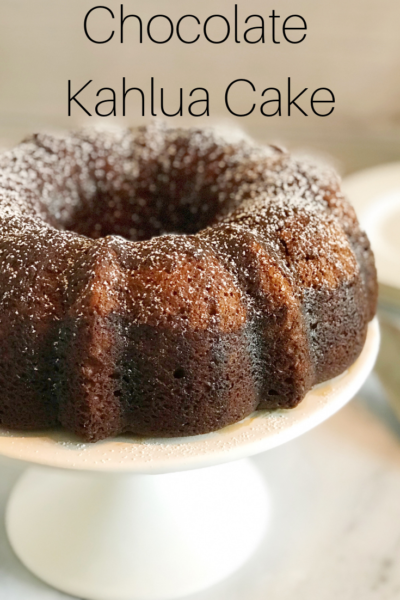 Chocolate Kahlua Cake: This boozy cake recipe is a delicious twist on a classic bundt cake. It's made with yellow cake mix, liquor and chocolate pudding mix. Then topped with a chocolate glaze. #BoozyCake #Kahlua #CakeRecipe #ChocolateCake #BundtCake #KahluaRecipe #Dessert #EasyDessert #Baking