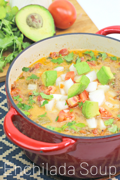 Enchilada Soup Recipe: This hearty one-bowl dinner is full of southwest flavor and the perfect winter meal idea. #Soup #SoupRecipe #EnchiladaSoup #SouthWestRecipe #MexianRecipe #Avocado #GrounBeefSoup #WinterRecipe