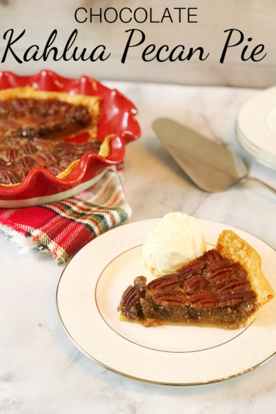 Kahlua Pecan Pie Recipe: This twist on the classic southern dessert includes a sweet boozy touch. Perfect for a Thanksgiving or Christmas dessert, it's a rich pie that people love! #PecanPie #PecanPieRecipe #Kahlua #BoozyPieRecipe #ChristmasDessert #ThanksgivingDessert #ThanksgivingRecipe