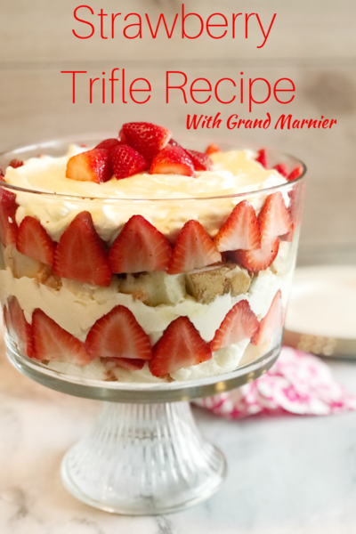 The Best Strawberry Trifle Recipe: layers of Grand Marnier soaked angel food cake, real whipped cream mixed with vanilla pudding and strawberries! #TrifleRecipe #PatrioticRecipe #LayeredDessert #Dessert #SummerDessert #BoozyCake #BoozyDessert