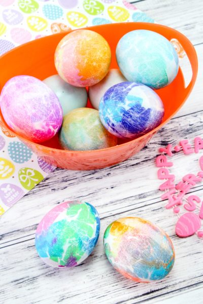 Tissue Paper Dyed Easter Eggs: If you want an easy way to dye eggs, check out this tissue paper method! It's perfect for kids and doesn't require vinegar. #Easter #EasterEggDying #EasterEggs #Eastercrafts #EasterKidsCrafts