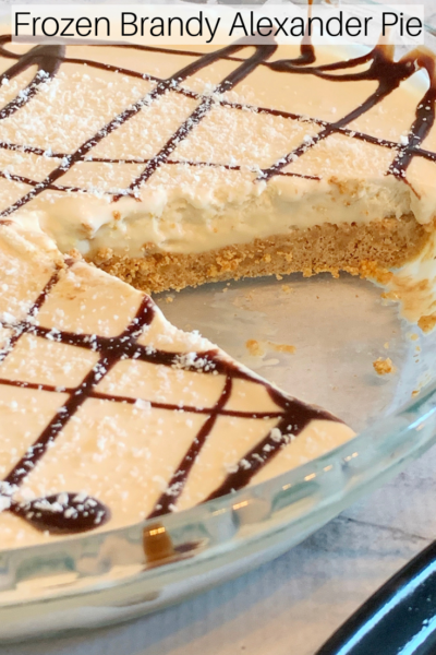 Frozen Brandy Alexander Pie: This easy pie recipe is creamy, boozy and delicious! Inspired by the classic cocktail, it's a refreshing summer dessert! #Pie #Dessert #FrozenDessert #SummerDessert #FrozenPie #BrandyAlexander #CocktailRecipe #BoozyPie