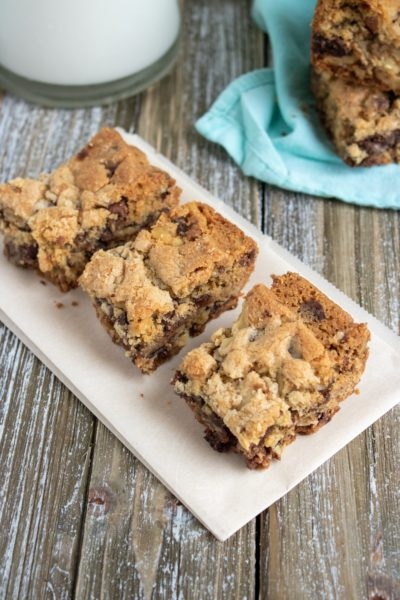 These Chocolate Chip Walnut Bars are a decadent treat that bakes in 30 minutes! #Baking #Dessert #DessertBars #ChocolateChips #ChristmasBaking