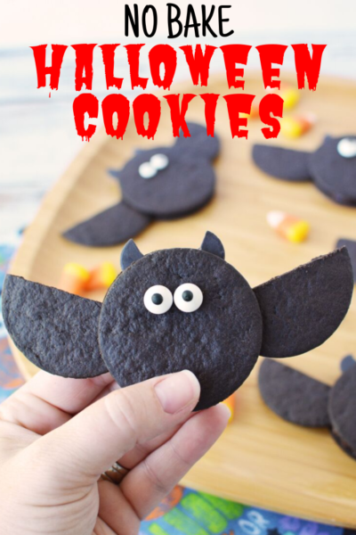 Need an easy Halloween Kids Dessert? These No Bake Halloween Cookies are super simple and cute! Make a big batch for Halloween parties without much effort. #Halloween #HalloweenDesset #HalloweenTreats #HalloweenCookies #NoBakeCookies #NoBake #BatCookies