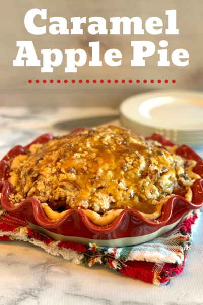 This Caramel Apple Pie recipe is the most decadent fall pie. Serve with vanilla ice cream, while enjoying the sweet caramel, pecans and baked apples. #Apple #ApplePie #AppleRecipe #DutchApplePie #CaramelApple