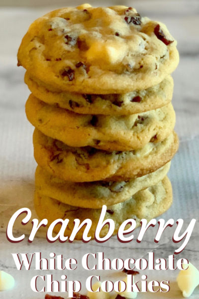 These Cranberry White Chocolate Chip Cookies are easy Christmas cookies! They're delicious drop cookies and a festive holiday dessert idea. #ChristmasCookies #HolidayBaking #Cranberry