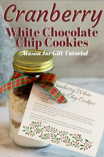 Cookie Mason Jar Gift Tutorial: this is the perfect budget-friendly homemade Christmas gift! See how to layer the dry ingredients and then just print the FREE recipe card, then tie with a beautiful holiday ribbon. Super simple! #MasonJarGift #ChristmasCookies #HomemadeGift #ChristmasGift #HolidayGift #ChristmasCookies #CranberryWhiteChocolateChip