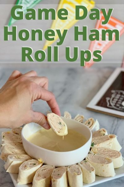 Need an easy SuperBowl appetizer? These honey ham tortilla roll ups with honey mustard dipping sauce are a favorite game day recipe! It's one of the best SuperBowl recipes that everyone loves. #SuperBowlRecipes #EasyAppetizer #SuperBowlFood #SuperBowlAppetizer #TailgatingRecipes #GameDayIdeas #GameDayRecipes #Appetizer #Ham #DeviledHam