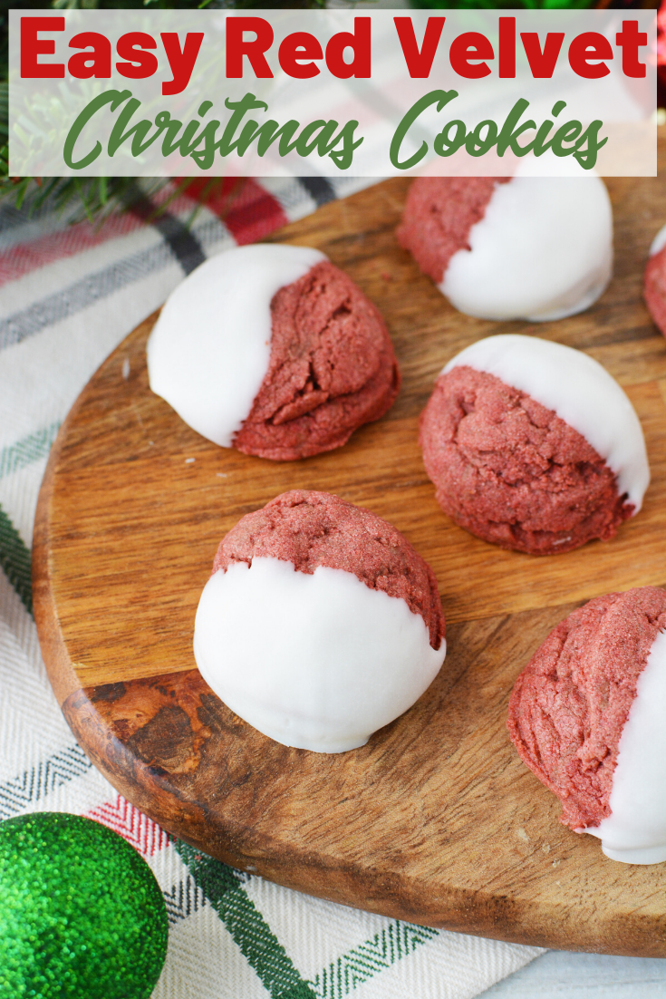 These Red Velvet Cookies are made with a cake mix base - perfect for easy clean up and beginner bakers! #ChristmasCookieRecipe #ChristmasCookies #CookieExchange #RedVelvet #RedVelvetCookies #CakeMixCookies #DippedCookies #HolidayBaking #HolidayCookies