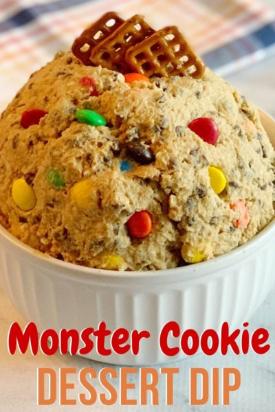 This Monster Cookie Dip recipe is so addicting! Made with peanut butter, M&M, candy, chocolate chips and quick oats, it's so easy to make. Serve with pretzels for a party or movie night! #Dessert #DessertDip #DipRecipes #MonsterCookieRecipe #CookieRecipe #CookieDough #CookieDoughRecipes