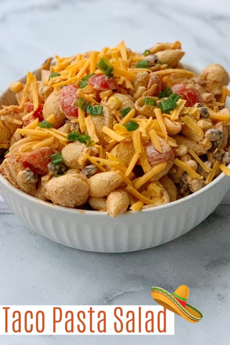 This easy Taco Pasta Salad recipe is a family favorite. Made with shell pasta, black beans, cheddar cheese, tomatoes and a taco seasoned dressing - it's a delicious family meal idea. Make it ahead of time for BBQ's, lunches and picnics. #TacoNight #TacoPastaSalad #PastaSalad #SaladRecipe #TacoRecipes #TacoNightRecipes #EasyPastaSaladRecipes #SummerSaladRecipes