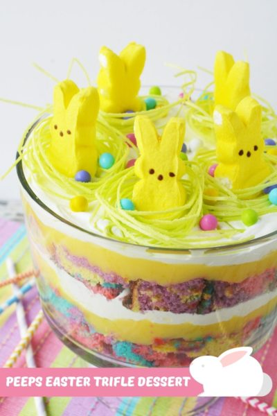 Bright, fun and delicious, this Easter Trifle dessert recipe will be a showstopper for your holiday. Just layer cake, cool whip and pudding together. Kids love it! #Easter #EasterTrifle #EasterDessertRecipes #EasyEasterDessertIdeas