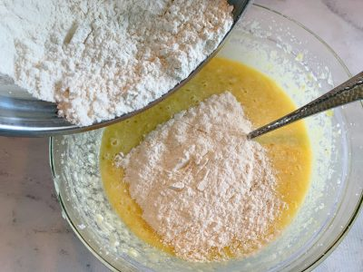 Adding flour mixture the cake