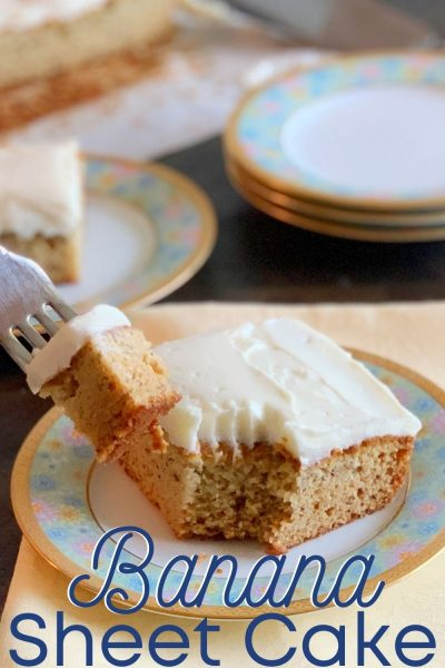 If you have leftover ripe bananas, you've got to make this delicious sweet Banana Sheet Cake recipe! It's topped with a cream cheese frosting and everyone asks for a second helping. #BananaRecipe #BananaSheetCake #BananaDessert #SheetCake
