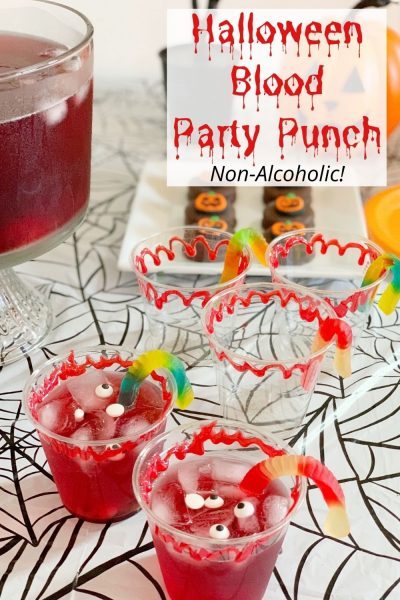 This Non-alcoholic Halloween Party Punch Recipe is a little gory, but sweet and delicious! Make a big batch and serve in fake blood rimmed cups, with gummy worms and eyeballs!