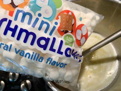 Adding mini marshmallows into the pot