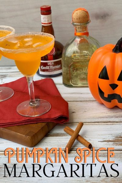 Ready for fall, but it's still hot? This Pumpkin Spice Margaritas recipe is the trick! They've got a smooth finish with the pumpkin spice flavor everyone loves. Perfect for Thanksgiving, Halloween or any fall festivity. #Margaritas #PumpkinSpiceMargaritas #HalloweenCocktail #ThanksgivingCocktail #FallCocktail