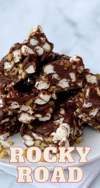 This decadent Rocky Road Candy recipe is a big hit! Just melt chocolate and condensed milk, then stir in your walnuts and marshmallows. It makes a great Christmas gift too! #RockyRoad #ChristmasCandy #RockyRoadCandy