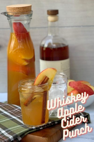 Perfect for crisp fall nights, this Whiskey Apple Cider Punch has fall spices, a smooth finish and a bit of sweetness. Make a party punch batch or single serve cocktails! #FallRecipe #FallCocktail #FallDrinkRecipe #AppleCider #SpikedAppleCider #PartyPunchRecipe