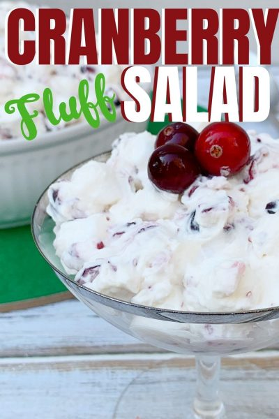 Need a Christmas Side Dish Recipe? This Cranberry Fluff Salad is a colorful addition! It's made with crushed pineapple, fresh cranberries and a dressing. It's everyone's favorite southern holiday recipe! #DessertSalad #CranberryFluffSalad #CranberrySalad #ChristmasSideDish #ChristmasRecipe #ChristmasSideDishRecipe