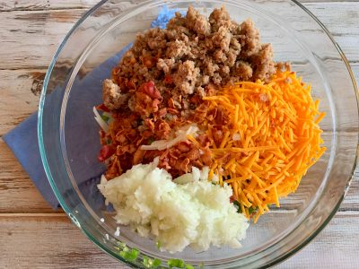 Mixing Overnight Brunch Casserole Recipe ingredients together