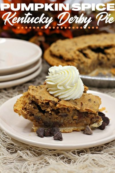 With a Pumpkin Spice twist, this Kentucky Derby Pie is a Thanksgiving dessert favorite! It has chewy texture with chocolate chips, pecans and bourbon. #PumpkinSpice #ThanksgivingPieRecipes #Thanksgiving #ThanksgivingRecipe