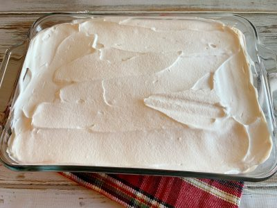 Topping frozen Christmas dessert with Cool Whip topping