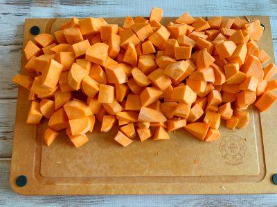 Chopped Sweet Potatoes, Chopping Sweet Potatoes On Cutting Board