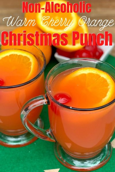 Sweet, with hints of cinnamon and clove, this Non-Alcoholic Christmas Punch recipe is always a hit! Warm it over the stove for a festive treat that the whole family can enjoy. #ChristmasDrinkRecipe #ChristmasPunch #ChristmasRecipe