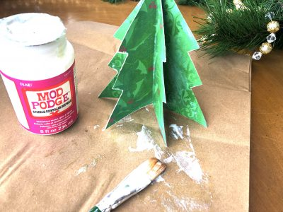 Adding Podge Podge Sparkle To Christmas Tree