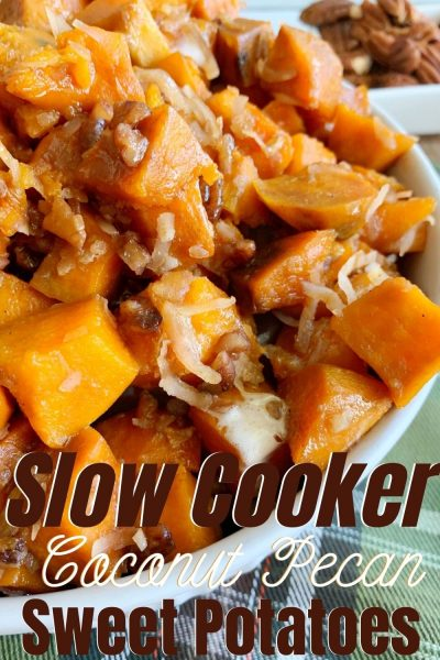 Keep Thanksgiving easy with these Slow Cooker Sweet Potatoes. They've got chopped pecans, coconut and marshmallow for the ultimate side dish recipe. #Thanksgiving #ThanksgivingRecipe #ThanksgivingSideDish #SweetPotatoes #SweetPotatoesRecipe