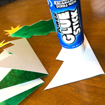 Applying glue to folded Christmas tree