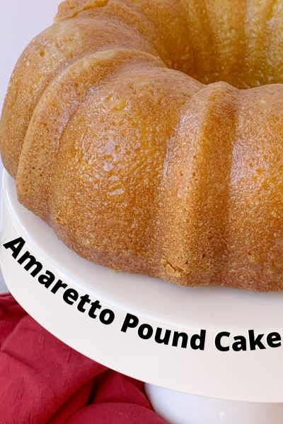 This boozy Bundt Cake recipe is a favorite! It's dense with amaretto liqueur baked in AND an amaretto glaze to finish it. #Amaretto #PoundCake #BundtCake #CakeRecipe