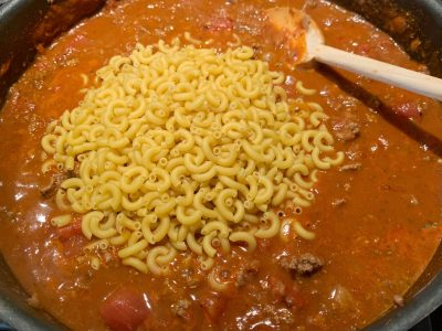 Adding macaroni to the ground beef