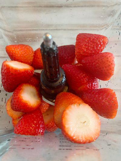 Blending strawberries in blender