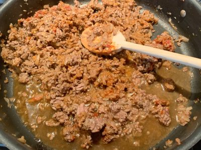 Cooking ground beef over stove