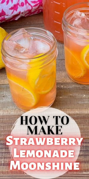 How to make homemade strawberry lemonade moonshine using Everclear. It's the perfect large batch refreshing summer cocktail. #Moonshine #SummerCocktail #CocktailRecipe #SouthernRecipe