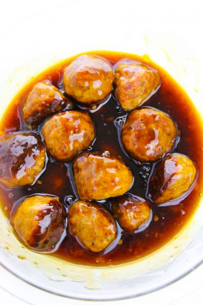 Coating meatballs in asian glaze sauce