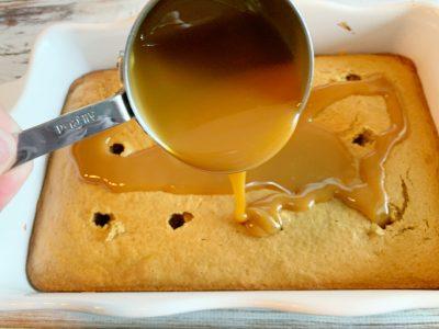 Adding caramel to poke cake
