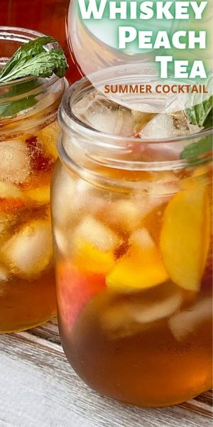 This Whiskey Peach Punch is a large batch summer cocktail recipe. It's a blend of fresh peaches, peach puree, sweet tea and whiskey. It's so refreshing!